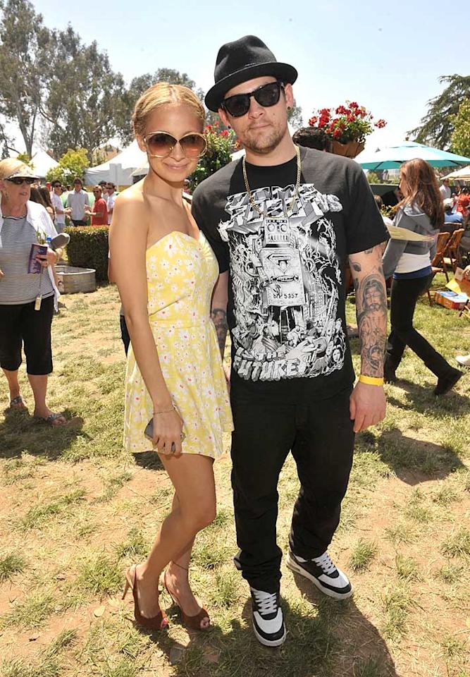 "Nicole Richie takes a break from the festivities to pose with boyfriend Joel Madden. As usual, the Good Charlotte frontman is dressed from head to toe in black. Lester Cohen/<a href=""http://www.wireimage.com"" target=""new"">WireImage.com</a> - June 8, 2008"
