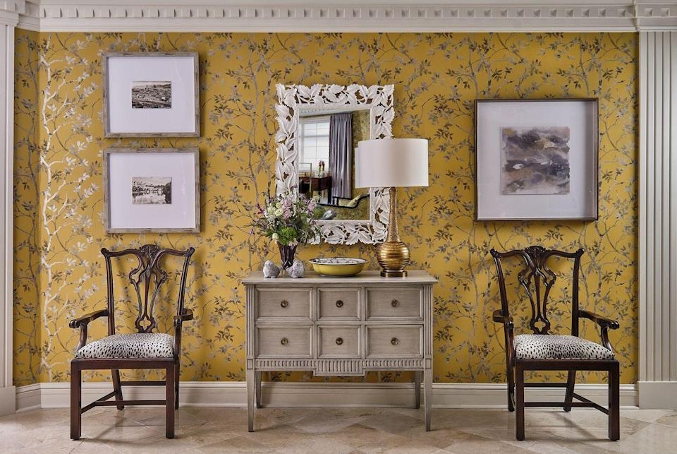 """<p>""""I love the idea of creating an interior environment that encapsulates the very essence of autumn,"""" says Turner. She used a gorgeous Thibaut wallcovering of printed silvery olive-brown fall leaves against an enchanting golden backdrop in this living room. </p>"""