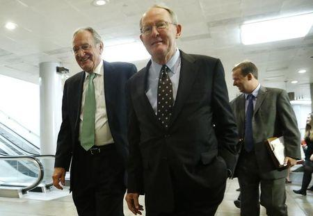 U.S. Senators Harkin and Senator Alexander walk to a closed-door briefing on talks with Iran, at the U.S. Capitol in Washington