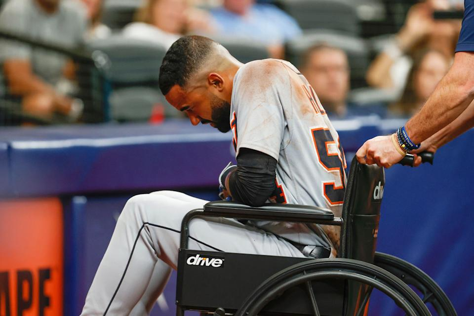 Detroit Tigers' Derek Hill is wheeled off the field during the fifth inning of a baseball game against the Tampa Bay Rays  Saturday, Sept. 18, 2021, in St. Petersburg, Florida.