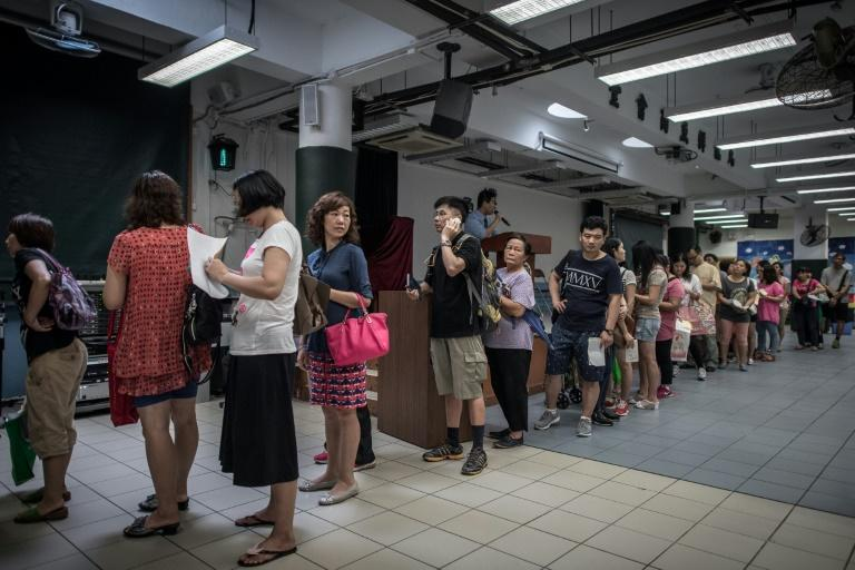 Parents queue to buy textbooks for their children on the first day of school in Hong Kong on September 1, 2015