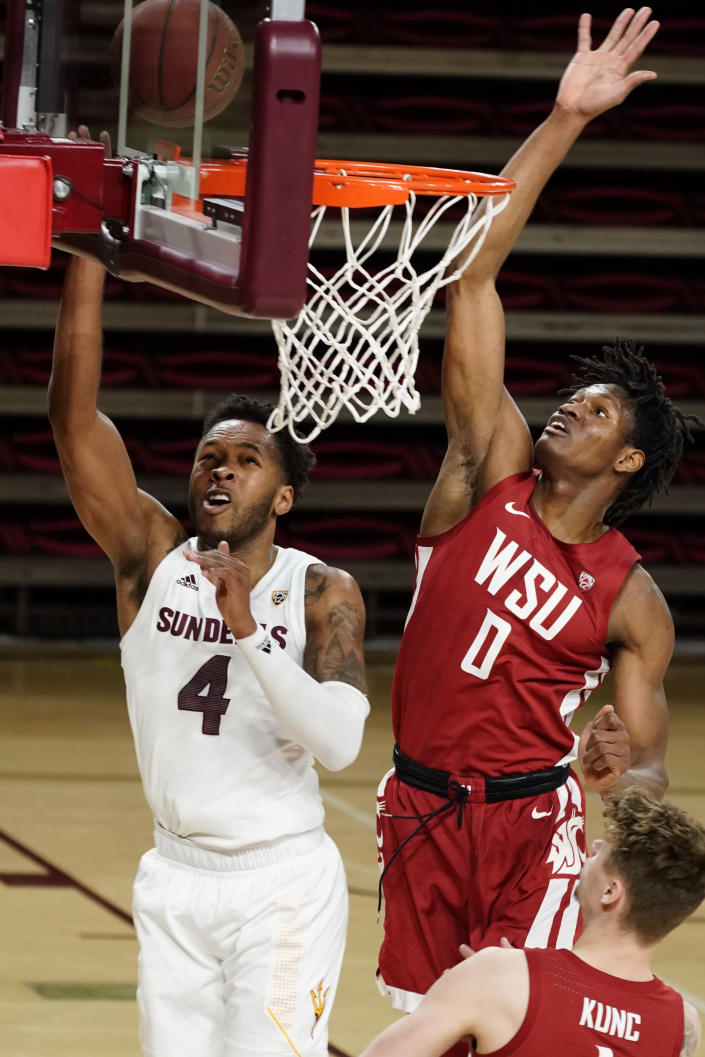 FILE - In this Saturday, Feb. 27, 2021 file photo, Arizona State forward Kimani Lawrence drives past Washington State center Efe Abogidi (0) during the first half of an NCAA college basketball game, in Tempe, Ariz. (AP Photo/Rick Scuteri, File)