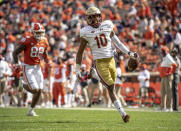 Boston College defensive back Brandon Sebastian (10) returns a fumble 97-yards past Clemson tight end Braden Galloway (88) for a touchdown during the first half of an NCAA college football game against Clemson Saturday, Oct. 31, 2020, in Clemson, S.C. (Josh Morgan/Pool Photo via AP)