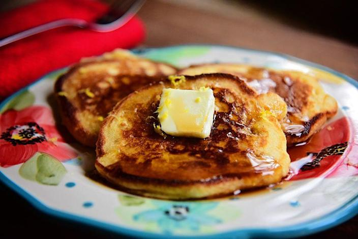"""<p>Topping your pancakes with lemon zest (and mixing some juice into the batter) is a great way to add freshness to your plate. Trust us, you'll love it! </p><p><strong><a href=""""https://www.thepioneerwoman.com/food-cooking/recipes/a88645/lemon-pancakes/"""" rel=""""nofollow noopener"""" target=""""_blank"""" data-ylk=""""slk:Get Ree's recipe."""" class=""""link rapid-noclick-resp"""">Get Ree's recipe. </a></strong></p><p><strong><a class=""""link rapid-noclick-resp"""" href=""""https://go.redirectingat.com?id=74968X1596630&url=https%3A%2F%2Fwww.walmart.com%2Fip%2FPancake-Batter-Dispenser-with-Measuring-Label-Perfect-for-Baking-Cupcakes-Waffles-Cakes-and-Muffins-No-Drip-Dispenser-by-Chef-Buddy%2F29015215&sref=https%3A%2F%2Fwww.thepioneerwoman.com%2Ffood-cooking%2Fmeals-menus%2Fg36146701%2Fbest-pancake-toppings%2F"""" rel=""""nofollow noopener"""" target=""""_blank"""" data-ylk=""""slk:SHOP BATTER DISPENSERS"""">SHOP BATTER DISPENSERS </a></strong></p>"""
