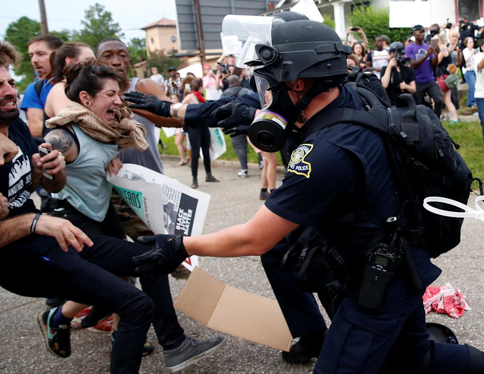 Demonstrators scuffle with police during protests in Baton Rouge, Louisiana, U.S., July 10, 2016. REUTERS/Shannon Stapleton