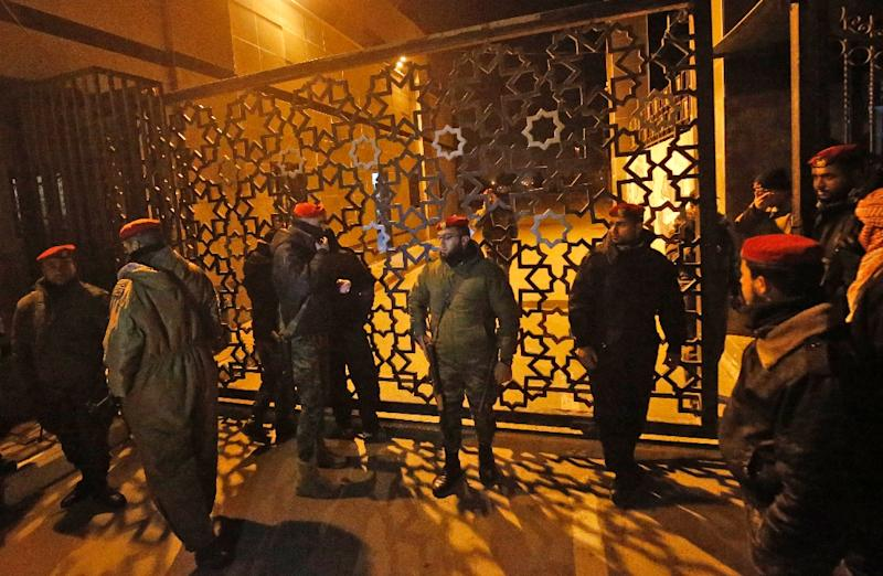 Palestinian security forces loyal to Hamas stand guard outside the Rafah border crossing with Egypt on January 7, 2019 as Palestinian Authority staff leave amid mounting infighting