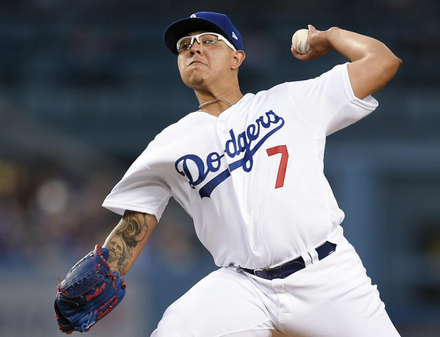 Los Angeles Dodgers starting pitcher Julio Urias throws to San Francisco Giants' Steve Duggar during the first inning of a baseball game in Los Angeles, Monday, April 1, 2019. (AP Photo/Kelvin Kuo)