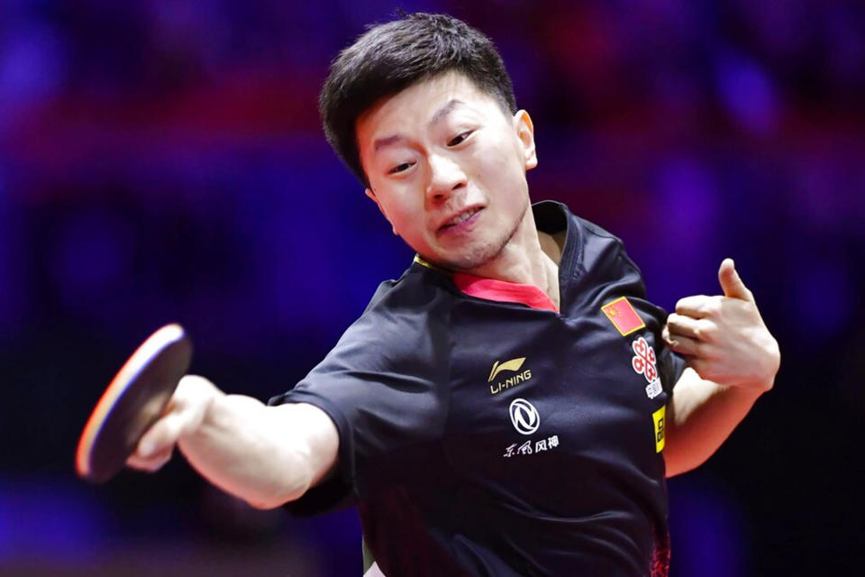 Ma Long plays in the Sweden in the men's singles final at the world table tennis championships in Budapest. - Credit: KYDPL KYODO/AP