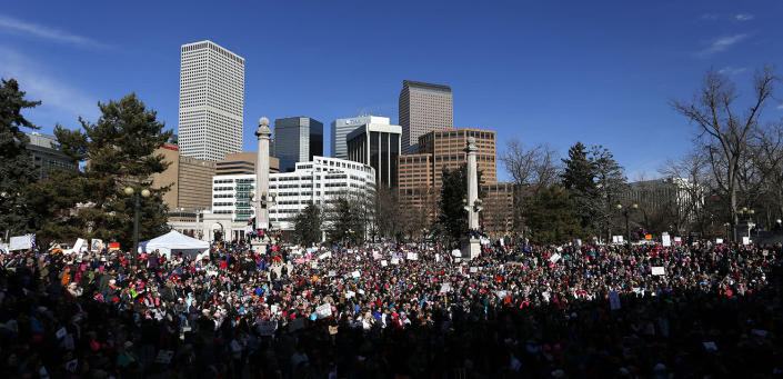 <p>Anti-Trump crowds chant and raise home-made signs during a women's march and rally in Denver, Saturday, Jan. 21, 2017. (AP Photo/Brennan Linsley) </p>