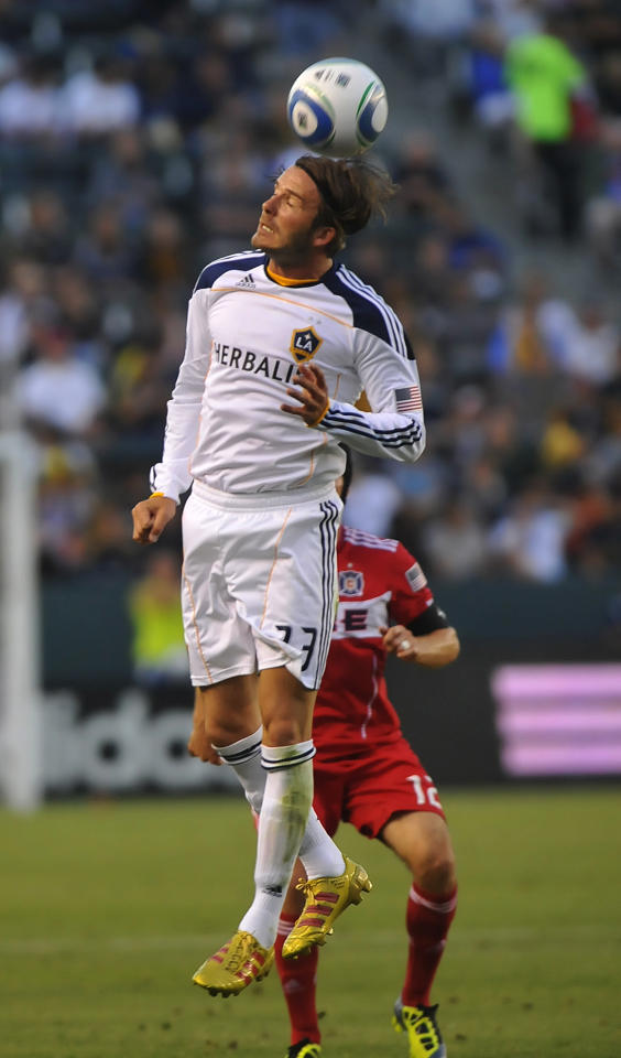 Los Angeles Galaxy midfielder David Beckham heads the ball in front of  Chicago Fire midfielder Logan Pause during the first half of an of an MLS soccer match, Saturday, July 9, 2011 in Carson, Calif. (AP Photo/Richard Hartog)