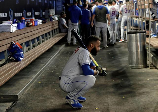 New York Mets shortstop Amed Rosario holds a bat in the dugout before a baseball game against the Miami Marlins, Saturday, May 18, 2019, in Miami. The Marlins won 2-0. (AP Photo/Lynne Sladky)