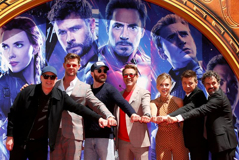 Actors Robert Downey Jr., Chris Evans, Mark Ruffalo, Chris Hemsworth, Scarlett Johansson, Jeremy Renner and Marvel Studios President Kevin Feige pose for a photo at the handprint ceremony at the TCL Chinese Theatre in Hollywood, Los Angeles, California, U.S. April 23, 2019. REUTERS/Mario Anzuoni
