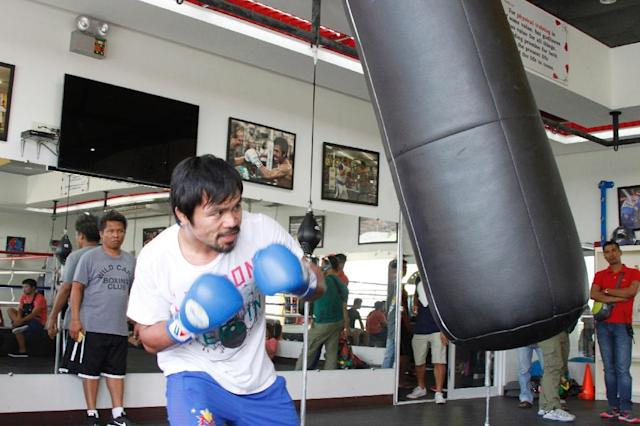 Philippine boxing icon Manny Pacquaio trains at a gym in General Santos City in southern island of Mindanao on February 21, 2015 (AFP Photo/)