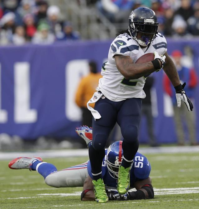 Seattle Seahawks running back Marshawn Lynch (24) avoids the tackle of New York Giants middle linebacker Jon Beason (52) during the first half of an NFL football game on Sunday, Dec. 15, 2013, in East Rutherford, N.J. (AP Photo/Kathy Willens)