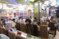 FILE PHOTO: Afghan men are seen in a restaurant in Herat