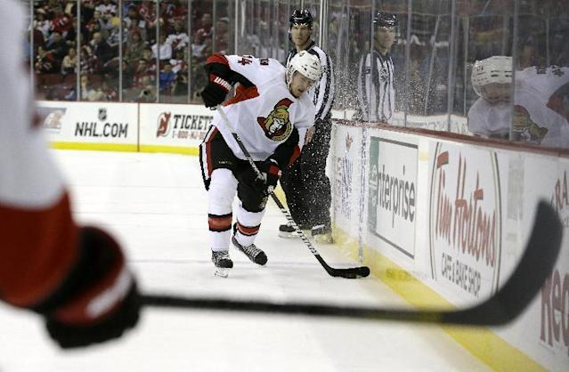 Ottawa Senators left wing Colin Greening (14) looks to pass the puck to a teammate during the first period of an NHL hockey game against the New Jersey Devils, Wednesday, Dec. 18, 2013, in Newark, N.J. (AP Photo/Julio Cortez)