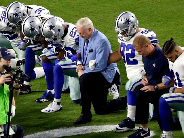 <p>The Dallas Cowboys, led by owner Jerry Jones, center, take a knee prior to the national anthem prior to an NFL football game against the Arizona Cardinals, Monday, Sept. 25, 2017, in Glendale, Ariz. (AP Photo/Matt York) </p>
