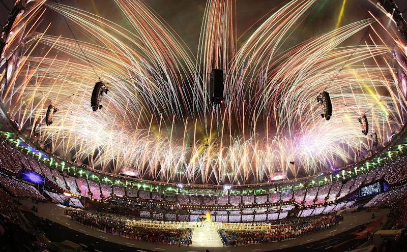 In this photo taken with a fisheye lens, pyrotechnics light up the sky above the Olympic Stadium during the Closing Ceremony at the 2012 Summer Olympics, Sunday, Aug. 12, 2012, in London. (AP Photo/Julio Cortez)