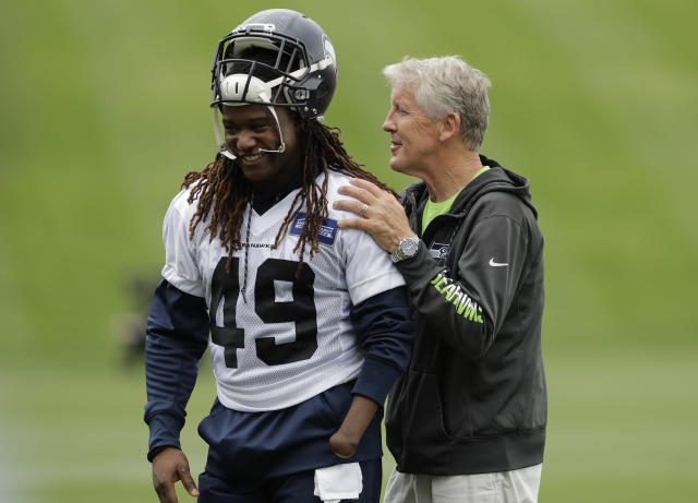 Seattle Seahawks head coach Pete Carroll, right, talks with linebacker Shaquem Griffin following NFL football practice, Thursday, June 14, 2018, in Renton, Wash. (AP Photo/Ted S. Warren)