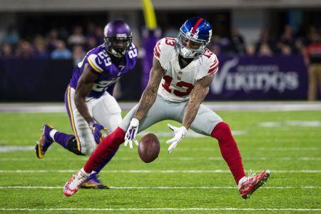 Oct 3, 2016; Minneapolis, MN, USA;  New York Giants wide receiver Odell Beckham Jr. (13) drops a pass during the third quarter against the Minnesota Vikings at U.S. Bank Stadium. The Vikings defeated the Giants 24-10. Mandatory Credit: Brace Hemmelgarn-USA TODAY Sports