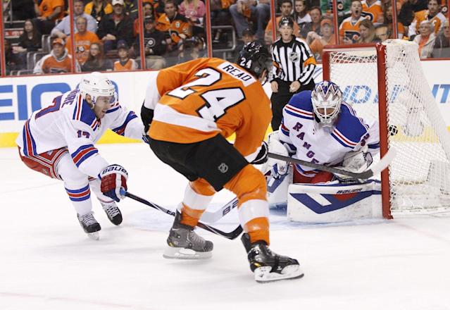 Philadelphia Flyers' Matt Read, center, shoots the puck past New York Rangers' Henrik Lundqvist, right, of Sweden, for a goal as John Moore tries to defend during the first period in Game 4 of an NHL hockey first-round playoff series on Friday, April 25, 2014, in Philadelphia. (AP Photo/Chris Szagola)