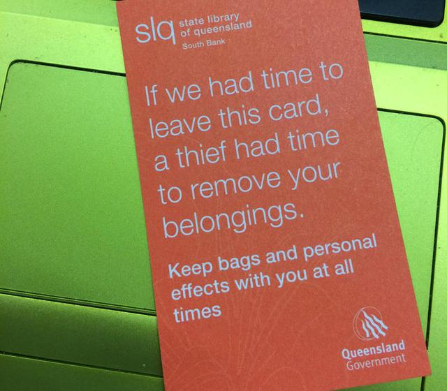 A note from State Library of Queensland warns people not to leave belongings unattended.