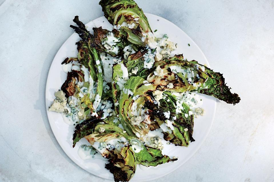 "To take this to a traditional wedge salad place, grill some thick-cut bacon and crumble it over the top. <a href=""https://www.epicurious.com/recipes/food/views/savoy-cabbage-wedges-with-buttermilk-dressing?mbid=synd_yahoo_rss"" rel=""nofollow noopener"" target=""_blank"" data-ylk=""slk:See recipe."" class=""link rapid-noclick-resp"">See recipe.</a>"