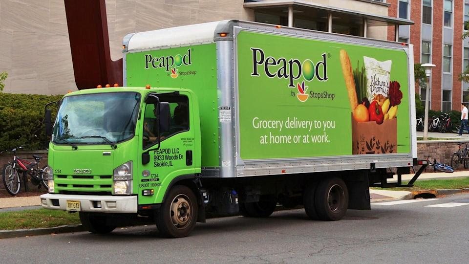 PRINCETON, NJ -14 OCTOBER 2015- A green Peapod by Stop and Shop truck is making a grocery delivery in New Jersey.