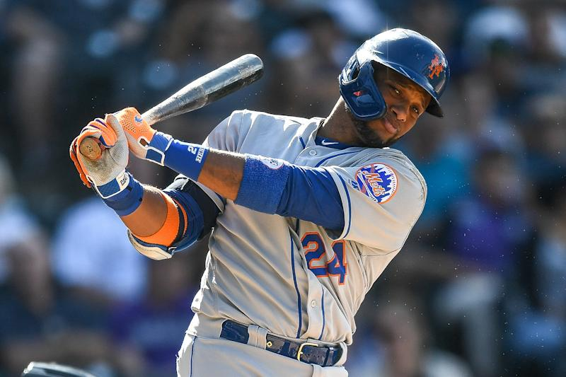 DENVER, CO - SEPTEMBER 18: New York Mets second baseman Robinson Cano (24) swings as he steps out of the box in a plate appearance against the Colorado Rockies during a game on September 18, 2019 at Coors Field in Denver, Colorado. (Photo by Dustin Bradford/Icon Sportswire via Getty Images)