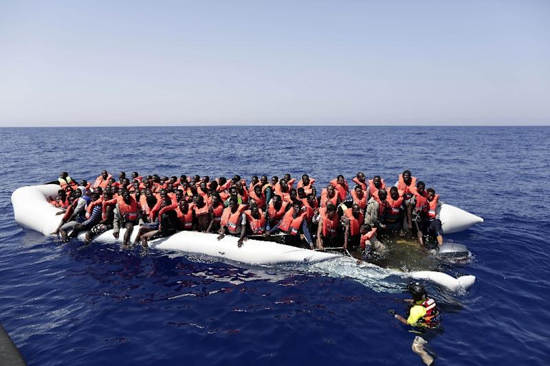 Migrants being rescued from a dinghy off the Libyan coast in the international waters between Malta and Libya