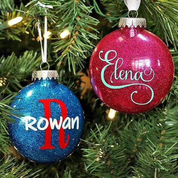 """<p>Make these sparkly ornaments in a snap, then personalize for all the people (or pets!) you love. </p><p><strong>Get the tutorial at <a href=""""https://www.wherethesmileshavebeen.com/diy-personalized-glitter-ornaments/"""" rel=""""nofollow noopener"""" target=""""_blank"""" data-ylk=""""slk:Where the Smiles Have Been"""" class=""""link rapid-noclick-resp"""">Where the Smiles Have Been</a>.</strong></p><p><a class=""""link rapid-noclick-resp"""" href=""""https://www.amazon.com/Darice-Heavy-Duty-Plastic-Funnel/dp/B002PNPGT0/?tag=syn-yahoo-20&ascsubtag=%5Bartid%7C10050.g.28831556%5Bsrc%7Cyahoo-us"""" rel=""""nofollow noopener"""" target=""""_blank"""" data-ylk=""""slk:SHOP CRAFT FUNNELS"""">SHOP CRAFT FUNNELS</a></p>"""