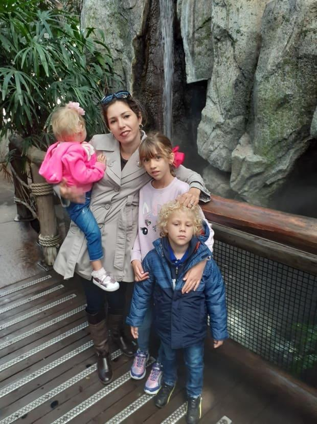Daylen Garcia Lopez is seen here at the Calgary Zoo with her two younger children, who are with her in Cuba, and her husband's daughter from a previous relationship.
