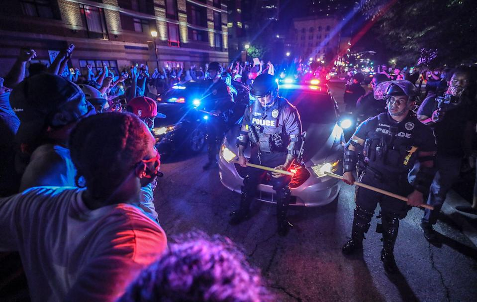 Police move protesters back as they try to move their patrol cars in Louisville, Ky., on May 28, 2020, during a wave of demonstrations that followed the deaths of Breonna Taylor and George Floyd.