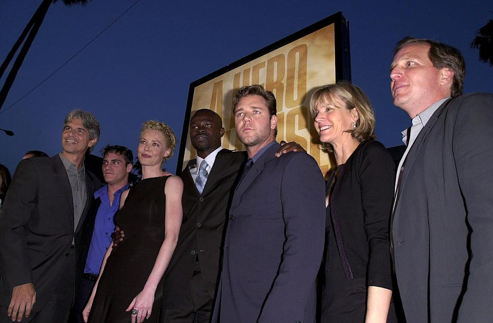 "BEVERLY HILLS, UNITED STATES:  US filmmakers of ""The Gladiator"" pose at the film's premiere (From L-R): executive Producer Walter Parkes, actor Joaquin Phoenix, actress Connie Nielsen, actor Djimon Hounsou, actor Russell Crowe, executive producer Laurie MacDonald, and producer Douglas Wick, in Beverly Hills, CA 01 May 2000.    (ELECTRONIC IMAGE)   AFP PHOTO/Lucy NICHOLSON/ln (Photo credit should read LUCY NICHOLSON/AFP via Getty Images)"