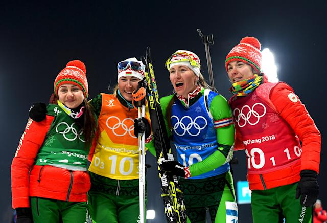 <p>Belarus's Iryna Kryuko, Dzinara Alimbekava, Darya Domracheva and Nadezhda Skardino celebrate winning gold after the Women's 4x6km Relay on day 13 of the PyeongChang 2018 Winter Olympic Games, February 22, 2018.<br> (Photo by Quinn Rooney/Getty Images) </p>