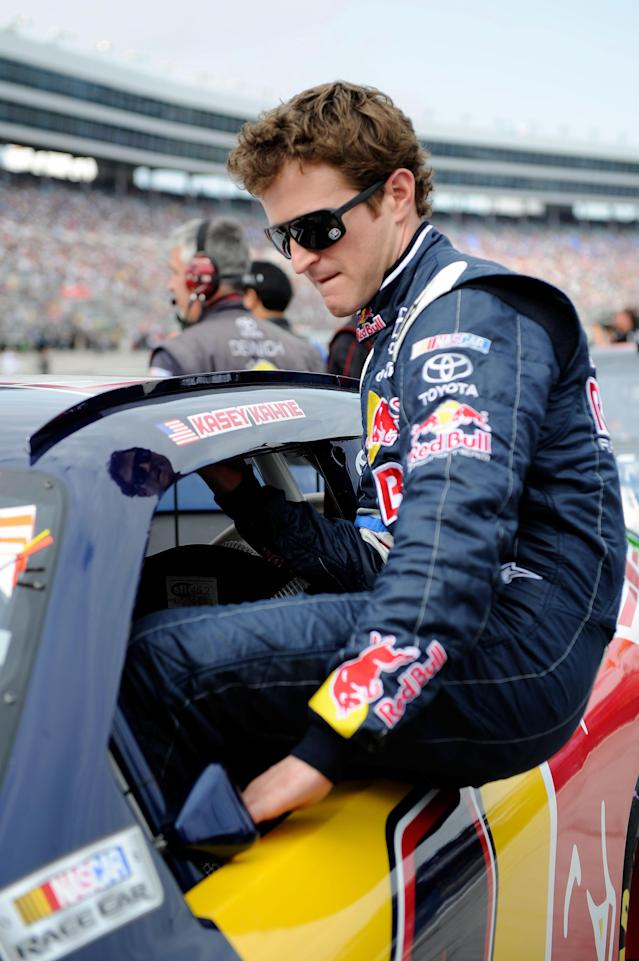 FORT WORTH, TX - NOVEMBER 06: Kasey Kahne, driver of the #4 Red Bull Toyota, climbs into his car on the grid during the NASCAR Sprint Cup Series AAA Texas 500 at Texas Motor Speedway on November 6, 2011 in Fort Worth, Texas. (Photo by John Harrelson/Getty Images for NASCAR)