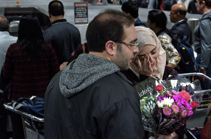 Dr. Muhamad Alhaj Moustafa and his wife Nabil Alhaffar, both Syrian citizens, meet after she returned from a trip to Doha, Qatar. She was denied re-entry in January at the international arrivals hall at Washington Dulles International Airport on Feb. 6, 2017.