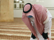 A Saudi worshipper wearing a face mask and gloves as he prays dawn prayers at al-Mirabi Mosque in Jiddah, Saudi Arabia, Sunday, May 31, 2020. The Ministry of Islamic Affairs said mosques will open to the public for prayers from May 31 until June 20, except in Mecca, with precautionary measures and instructions. (AP Photo/Amr Nabil)