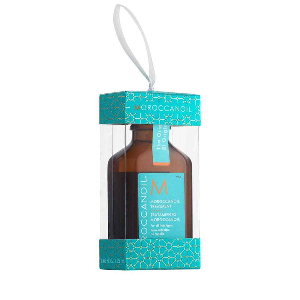 """<p><a rel=""""nofollow noopener"""" href=""""http://www.feelunique.com/p/Moroccanoil-Treatment-Ornament-25ml"""" target=""""_blank"""" data-ylk=""""slk:Feelunique"""" class=""""link rapid-noclick-resp"""">Feelunique</a> - £13.45</p><p>We can't imagine our hair routine without Moroccanoil's Treatment - it keeps frizz on lockdown, imparts a shampoo-ad shine <em>and </em>makes even the most course lengths feel like silk. So, we're calling it: This is the <em>ultimate </em>stocking filler. </p>"""
