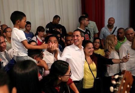 Venezuelan opposition leader Juan Guaido, who many nations have recognised as the country's rightful interim ruler, greets supporters in Maracay, Venezuela, April 26, 2019. REUTERS/Manaure Quintero