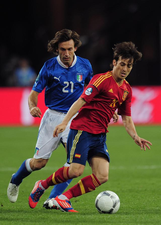 KIEV, UKRAINE - JULY 01: David Silva of Spain in action against Andrea Pirlo of Italy during the UEFA EURO 2012 final match between Spain and Italy at the Olympic Stadium on July 1, 2012 in Kiev, Ukraine. (Photo by Shaun Botterill/Getty Images)