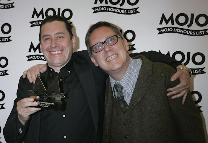 LONDON - JUNE 5: Jools Holland poses with The MOJO Medal Award with Vic Reeves at The MOJO Honours List awards, recognising career-long contributions to popular music, at Shoreditch Town Hall on June 5, 2006 in London, England. (Photo by Jo Hale/Getty Images)