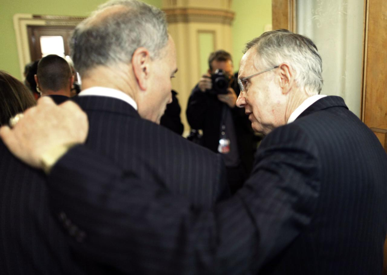 U.S. Senate Majority Leader Harry Reid (D-NV) (R) walks with his arm around Senator Charles Schumer (D-NY) as they depart following a news conference after bipartisan passage of budget and debt legislation at the U.S. Capitol in Washington, October 16, 2013. The U.S. Senate approved a deal on Wednesday to end a political crisis that partially shut down the federal government and brought the world's biggest economy to the edge of a debt default that could have threatened financial calamity. REUTERS/Jonathan Ernst (UNITED STATES - Tags: POLITICS BUSINESS)