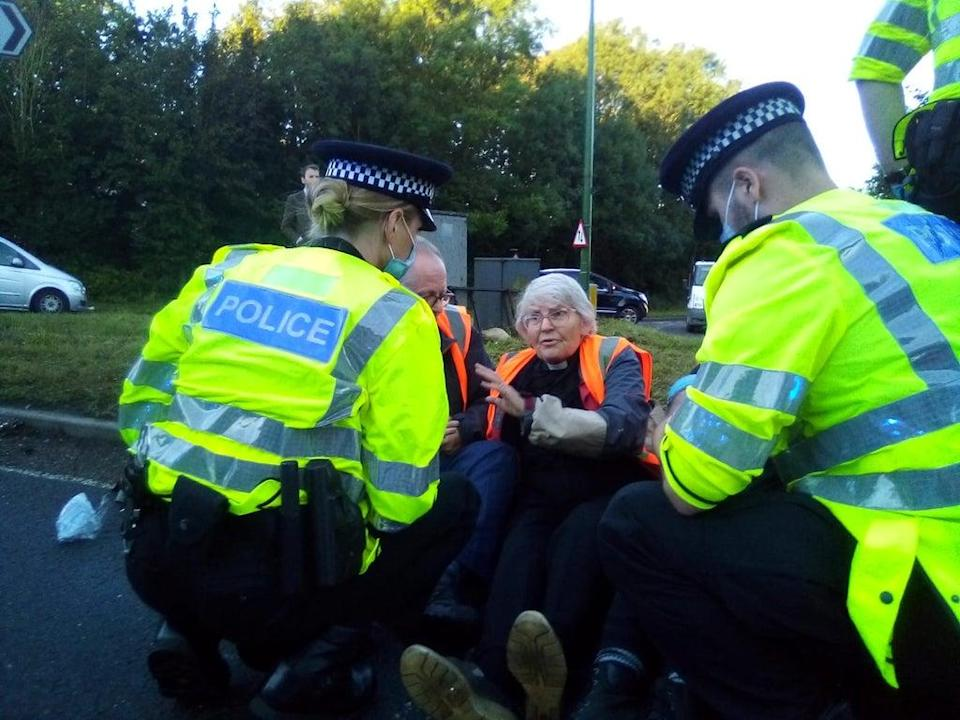 Protesters from Insulate Britain blocking a roundabout (Insulate Britain) (PA Media)