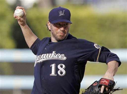 Milwaukee Brewers starter Shaun Marcum pitches to the Los Angeles Dodgers in the first inning of a baseball game in Los Angeles Monday, May 28, 2012.(AP Photo/Reed Saxon)