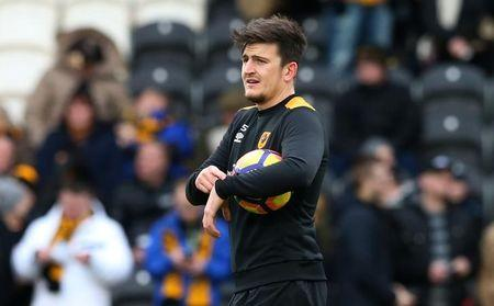 Hull City's Harry Maguire warms up before the game