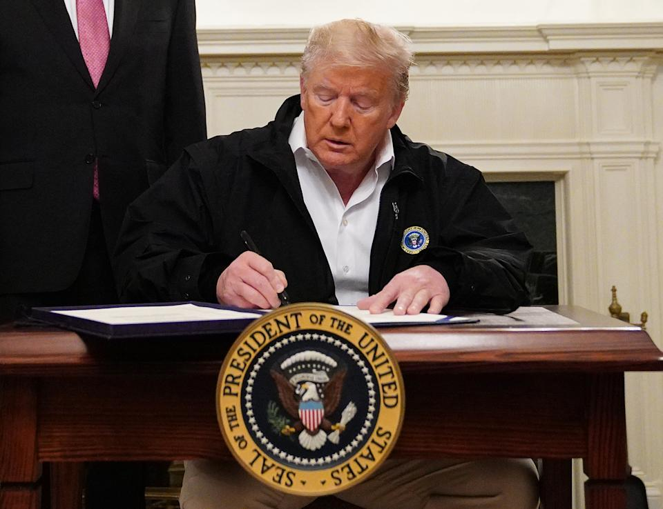US President Donald Trump signs a USD 8 billion emergency funding bill to combat COVID-19, coronavirus, in the Diplomatic Room of the White House in Washington, DC on March 6, 2020. (Photo by MANDEL NGAN / AFP) (Photo by MANDEL NGAN/AFP via Getty Images)