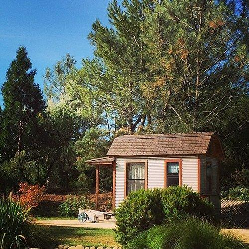 In Hopland, CA, is where you'll find this lovely tiny house in the woods. Who wouldn't want to spend their time here?