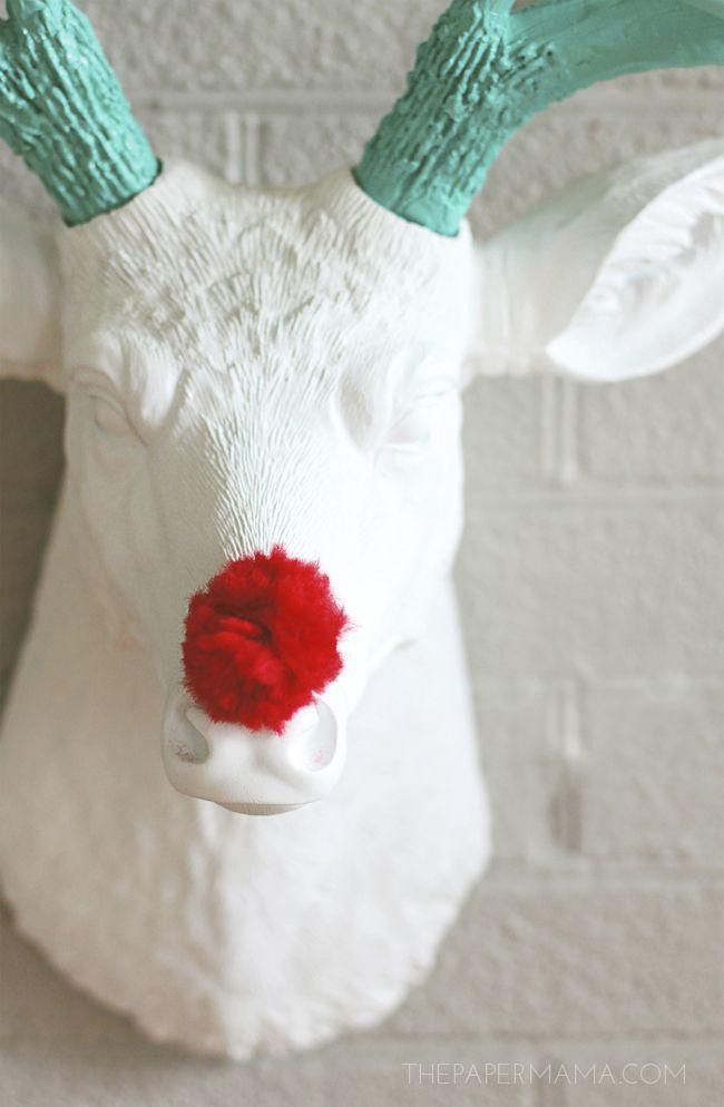 "<p>If your mantel typically features a deer head (faux or otherwise), here's a simple decorating idea: Add a red pom-pom nose inspired by Rudolph's.</p><p><em>Get the tutorial at <a href=""https://thepapermama.com/2014/12/holiday-mantel-makeover/"" rel=""nofollow noopener"" target=""_blank"" data-ylk=""slk:The Paper Mama"" class=""link rapid-noclick-resp"">The Paper Mama</a>.</em></p><p><a class=""link rapid-noclick-resp"" href=""https://www.amazon.com/YYCRAFT-Glitter-Tinsel-Sparkle-Toys-Red/dp/B07LG2LV52/?tag=syn-yahoo-20&ascsubtag=%5Bartid%7C10072.g.34484299%5Bsrc%7Cyahoo-us"" rel=""nofollow noopener"" target=""_blank"" data-ylk=""slk:SHOP RED POM-POM"">SHOP RED POM-POM</a></p>"