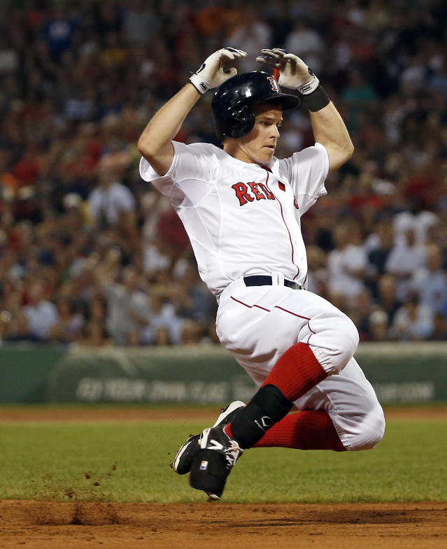 Boston Red Sox's Brock Holt slides in with a triple in the fifth inning of a baseball game againt the Chicago White Sox at Fenway Park in Boston, Tuesday, July 8, 2014. Holt scored later in the inning. (AP Photo/Elise Amendola)